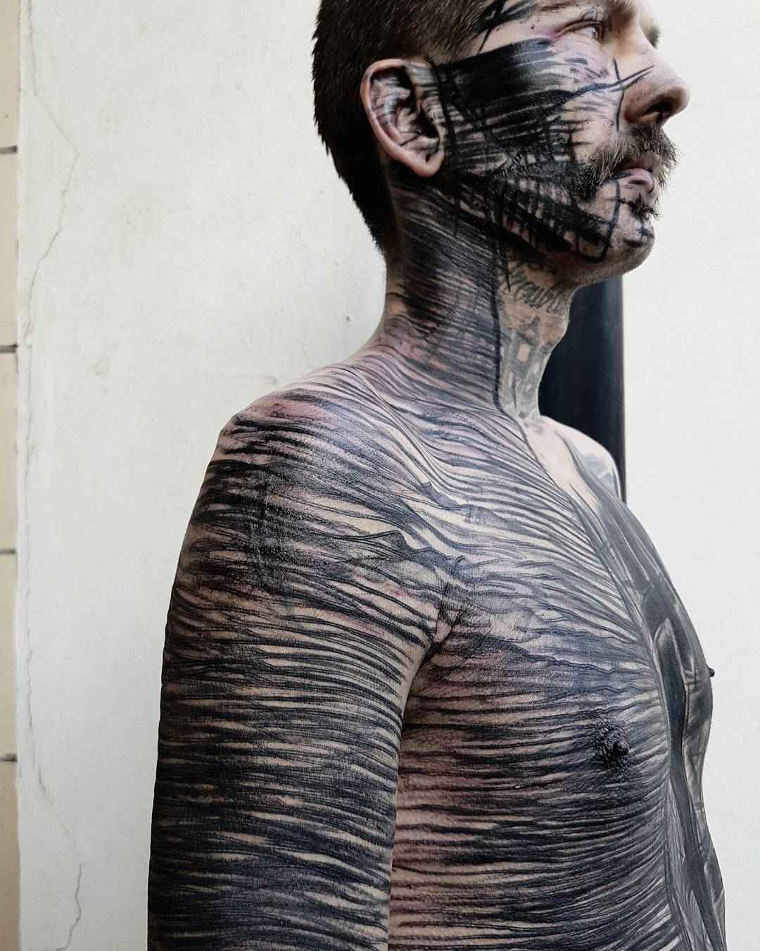 Brutal blackwork valerio cancellier inkppl tattoo for Blackwork tattoo artists